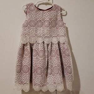 White lace dress with red lining
